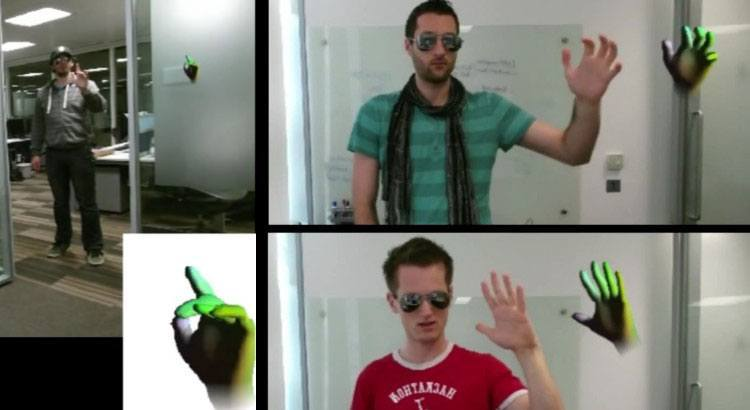 three men with their hands in the air using microsoft kinect finger tracking