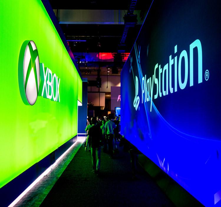 Giant Xbox logo and giant PS4 logo at E3