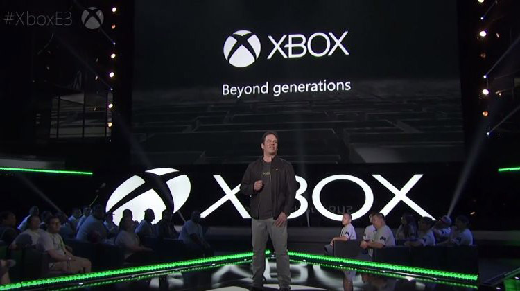 xbox logo with guy on stage making a speech